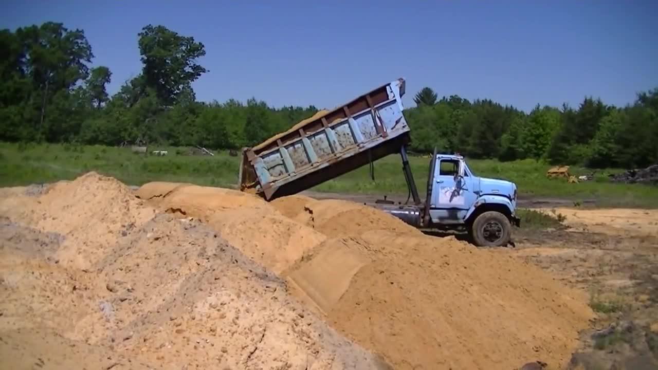 Trucks Moving Sand
