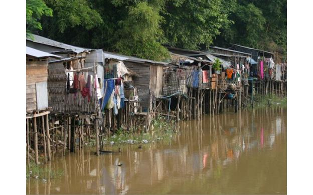 Huts on a River