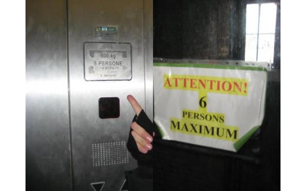 Same elevator, two different signs